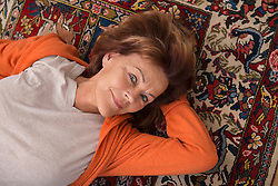 High angle view of senior woman lying on floor, Munich, Bavaria, Germany