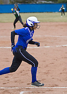 Middletown, New York - A Middletown batter runs to first base in a varsity girls' softball game on April 7, 2014.