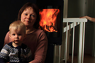 Junior high teacher Berit Karen Sokki Sabbasen with grandson, keeps the love and warmth of the extended Sami family burning in her modern home.