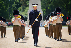 © London News Pictures. 10/06/2014. London, UK. The Massed Bands of the Household Division rehearse for the ceremonial 'Beating Retreat' event on Horse Guards Parade in London. The event, which is part of the celebration marking the Royal Marines' 350th anniversary, takes place on the year that marks the 100th anniversary of the start of the First World War, and the 70th anniversary of the Battle for D-Day. Also taking part in this years event are will be the Bands of the Troupes de Marine and the Légion étrangère, from the French Army. Photo credit : Tolga Akmen/LNP