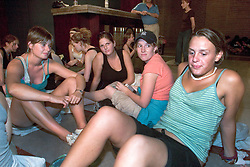 01 Sept, 2005. New Orleans, Louisiana.<br /> Mass evacuation begins. British tourists await evacuation from the Hyatt Hotel. The women, formally finding themselves at the Superdome were moved to the Arena for their own safety where they served as makeshift nurses. <br /> L/R; Zoe Smith, Jenny Sachs, Rhiannon Davies and Jane Wheeldon await evacuation in lobby of Hyatt hotel, New Orleans.<br /> Photo©; Charlie Varley/varleypix.com