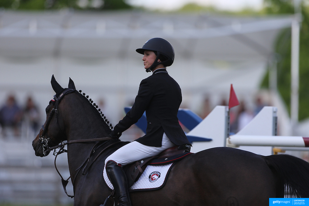 Georgine Bloomberg riding Caleno 3 in action during the $100,000 Empire State Grand Prix presented by the Kincade Group during the Old Salem Farm Spring Horse Show, North Salem, New York,  USA. 17th May 2015. Photo Tim Clayton