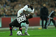 Moussa Sissoko of Tottenham Hotspur pushes Wendell of Bayer Leverkusen as he tries to go past him. UEFA Champions league match, group E, Tottenham Hotspur v Bayer Leverkusen at Wembley Stadium in London on Wednesday 2nd November 2016.<br /> pic by John Patrick Fletcher, Andrew Orchard sports photography.