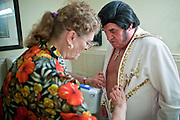 Aug. 2 - PHOENIX, AZ: JANE TRAPANI helps her husband, DONALD TRAPANI, get ready to perform as Elvis Presley.  Trapani, 68, was diagnosed with lung cancer in August 2009 and entered the care of Hospice of the Valley, the largest hospice organization in Phoenix, shortly after that. His doctor said he would be dead by the end of February 2010. Trapani is in still in the care of Hospice of the Valley, but his condition has improved. He now entertains other hospice patients singing the songs of Elvis Presley. He tries to hold one concert each week, his health permitting, at different hospice units in the Phoenix area.     Photo by Jack Kurtz