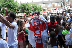 July 7, 2018 - London, London, United Kingdom - Football fans in Kirby Estate watch as England take on Sweden...Residents of the Kirby Estate fans celebrate under bunting and England flags as England score second goal in Russia 2018 World Cup against Sweden. Over hundred England flags and bunting cover the south London estate. (Credit Image: © Dinendra Haria/i-Images via ZUMA Press)