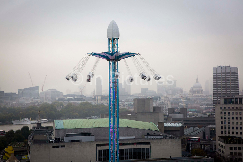 Tourists enjoying a carousel fairground ride called a Starflyer in Jubilee park on the South bank next to the Royal Festival Hall, London, United Kingdom. (photo by Andrew Aitchison / In pictures via Getty Images)