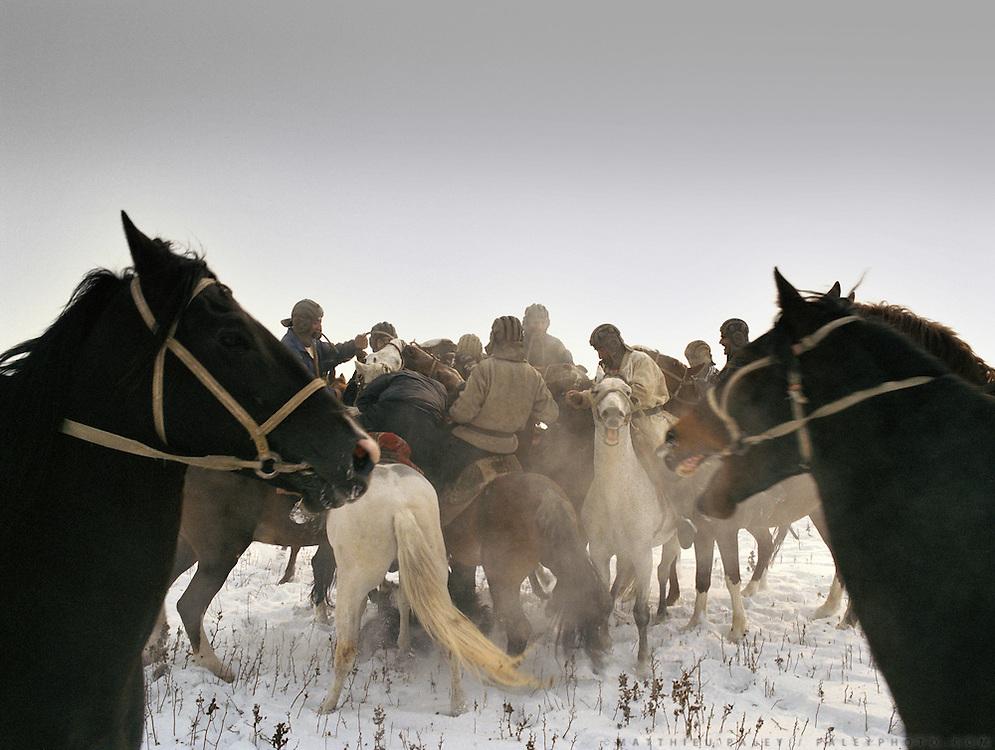 Buzkachi (central asian horse game) season starts in winter in Tajikistan, Dushanbe. En route to Afghanistan's Wakhan Corridor.