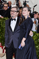 Gary Oldman and Gisele Schmidt walking the red carpet at The Metropolitan Museum of Art Costume Institute Benefit celebrating the opening of Heavenly Bodies : Fashion and the Catholic Imagination held at The Metropolitan Museum of Art  in New York, NY, on May 7, 2018. (Photo by Anthony Behar/Sipa USA)