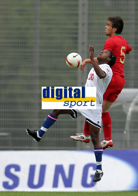20090324: FUNCHAL, MADEIRA, PORTUGAL - Portugal vs Cape Verde: XIII Madeira International Under 21 Tournament. In picture: Josi Duarte (Cabo Verde) and Miguel Vitor (Portugal) . <br />PHOTO: Octavio Passos/CITYFILES