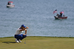 Team Europe's Tommy Fleetwood sets up a shot on the 3rd green during day three of the 43rd Ryder Cup at Whistling Straits, Wisconsin. Picture date: Sunday September 26, 2021.