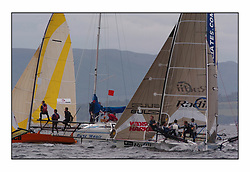 The 2004 Skiff Nationals at Largs held by the SSI.<br /> <br /> Onica, Radii and Link Associates come out the start line with Pure Magic as the commitee vessel.<br /> <br /> Marc Turner / PFM Pictures