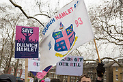 Fans and supporters of Dulwich Hamlet Football Club during a protest march from Goose Green to Champion Hill on 17th March 2018 in South London in the United Kingdom. The non-league, South London, club is gaining popularity following recent eviction by Meadow Residential, an American property investment fund, who want to turn the clubs ground, Champion Hill, into luxury flats. .