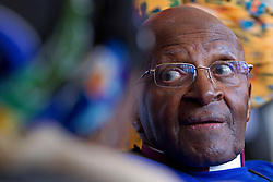 A frail looking but still delightful Archbishop Emeritus Desmond Tutu reacts to his wife Leigh during the annual Women's Day events that takes place yearly on Women's Day at Artscape Theatre Centre in Cape Town, South Africa. This event with Desmond Tutu and his wife Leigh took place shortly after the Women's Humanity Walk. This year's walk was an intergenerational celebration of the 60th anniversary of the 1956 Women's March where 20000 women marched on the Union Buildings in Pretoria, South Africa to protest for freedom and justice. Women from all walks of life and all religious and cultural backgrounds marched together in solidarity and in remembrance from the Slave Lodge to the Artscape Theatre in Cape Town, South Africa on the 9th August 2016.<br /> <br /> Photo by:   Mark Wessels / Real Time Images.
