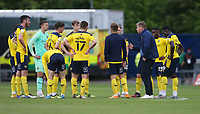 Oxford United manager Karl Robinson talks to his players at the end of the match<br /> <br /> Photographer Rob Newell/CameraSport<br /> <br /> Sky Bet League One Play-Off Semi-Final 1st Leg - Oxford United v Blackpool - Tuesday 18th May 2021 - Kassam Stadium - Oxford<br /> <br /> World Copyright © 2021 CameraSport. All rights reserved. 43 Linden Ave. Countesthorpe. Leicester. England. LE8 5PG - Tel: +44 (0) 116 277 4147 - admin@camerasport.com - www.camerasport.com