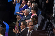 GOP Vice Presidential nominee Mike Pence, center, and his family listen to the acceptance address of running mate Donald Trump as the party nominee for president on the final day of the Republican National Convention July 21, 2016 in Cleveland, Ohio.