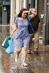 © Licensed to London News Pictures. 10/08/2019. London, UK. A woman runs for cover during a downpour on Green Lanes, Harringay in north London. Photo credit: Dinendra Haria/LNP