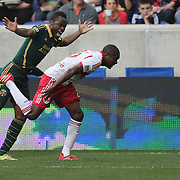 Steve Zakuani, (left), Portland Timbers, challenges Chris Duvall, New York Red Bulls, during the New York Red Bulls Vs Portland Timbers, Major League Soccer regular season match at Red Bull Arena, Harrison, New Jersey. USA. 24th May 2014. Photo Tim Clayton