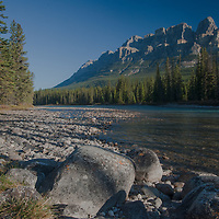 The Bow Rivers flows beneath Castle Mountain in Banff National Park, Alberta, Canada.  Mount Eisenhower is the tower on the right.