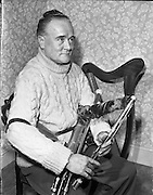 """Leo Rowsome.29/02/1959..Leo Rowsome (05/04/1903 – 20/09/1970) was the third generation of an unbroken line of uilleann pipers. He was performer, manufacturer and teacher of the uilleann pipes - the complete master of his instrument. He devoted his entire life to the uilleann pipes..Samuel Rowsome, Leo's grandfather sent his sons, John, Thomas and William to a German teacher of music who resided in Ferns, near their home in Co. Wexford to learn the theory of music and how to play various instruments. This knowledge was passed on through William to his son, Leo who made good use of it in his teaching, writing music for his many pupils..Leo was born in Harold's Cross, Dublin in 1903. His father, William realised that his son had the ability to become a talented musician and craftsman. Constantly watching his father making and repairing instruments, Leo learned the art of pipe making and instrument repair. So rapid was his progress at piping that in 1919 at the age of sixteen he was appointed teacher of the uilleann pipes at Dublin's Municipal School of Music (now D.I.T. Conservatory of Music & Drama) for 50 years. He also taught at Dublin's Pipers Club of which he was President..Leo was the first uilleann piper to perform on Irish National Radio in the early 1920s when he played solo and later in duets with Frank O'Higgins (fiddle), Micheal O Duinn (fiddle) and Leo's brother John (fiddle). Leo's """"All Ireland Trio"""" comprised Neilus Cronin, flute, Seamus O'Mahony, fiddle and Leo pipes. He formed his Pipes Quartet in the mid 1930s and broadcast regularly throughout the 1940s/50s. Leo was the first Irish artist to perform on BBC T.V. (1933). He made many recordings for Decca, Columbia and HMV. His last commercial recording, CC1 """"Ri na bPiobairi"""" (King of the Pipers) was made for Claddagh Records in 1966..Leo Rowsome died suddenly whilst adjudicating 'The Fiddler of Dooney Competition' in Riverstown, Co. Sligo on 20 September 1970..."""