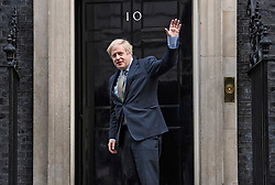 © Licensed to London News Pictures. 13/12/2019. London, UK. British Prime Minister BORIS JOHNSON is seen driving back at 10 Downing Street in London after meeting with the Queen. The Conservative party achieved a clear majority in the General Election which was called for December 12th following a deadlock in Parliament over the UK's decision to leave the EU. Photo credit: Ben Cawthra/LNP
