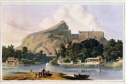 The Rock Of Tritchinolopy, Taken On The River Cauver The rock of Tritchinopoly is celebrated in the military annals of Hindoostan. This view is taken on the north side from the river Cauvery in the dry season. The building to the right on the western extremity of the rock is an ancient Hindoo temple, held in great veneration by the votaries of that religion ; and the lesser one on the summit, a Choultry, commanding a very rich and extensive prospect. Many small Choultries and places of worship also embellish the banks of the river. This with the following views of Tritchinopoly were taken in June, 1792. From the book ' Oriental scenery: one hundred and fifty views of the architecture, antiquities and landscape scenery of Hindoostan ' by Thomas Daniell, and William Daniell, Published in London by the Authors July 1, 1812