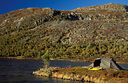 Camping, Tent in autumnal landscape, lake, soft golden colours, blue sky