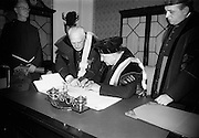 19/05/1966<br /> 05/19/1966<br /> 19 May 1966<br /> President Eamon de Valera receives Honorary Doctorate from the University of Louvain, Belgium at a conferring ceremony at the Department of External Affairs in Dublin. Picture shows President de Valera signing the register of the University. On left is Right Reverend  Monsignor Louis De Raeymaeker, Pro-Rector of The University of Louvain.  On right is Monsignor Edouard Massaux, Pro-Rector.
