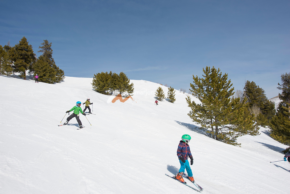 Family alpine skiing at Magic Mountain Ski Resort in Southern Idaho. MR