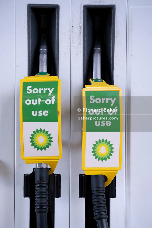 As the fuel transport crisis continues into its second week, sealed BP petrol and diesel pumps are covered in a closed petrol and fuel station in south London, on 27th September 2021, in London, England. The shortages at retailers around the country are caused by the UK's lack of qualified HGV (Heavy Goods Vehicles) drivers who deliver supplies to the nation's fuel forecourts, the majority of which are now closed after panic-buying drained fuel stock.