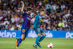 August 13, 2017 - Barcelona, Catalonia, Spain - FC Barcelona midfielder S. ROBERTO competes with Real Madrid forward LUCAS VAZQUEZ for the ball during the Spanish Super Cup Final 1st leg between FC Barcelona and Real Madrid at the Camp Nou stadium in Barcelona (Credit Image: © Matthias Oesterle via ZUMA Wire)