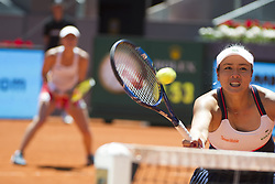 MADRID, May 14, 2017  Chan Yung-Jan (R) of Chinese Taipei and Martina Hingis of Switzerland compete during the women's doubles final match of the Mutua Madrid Open against Timea Babos of Hungary and Andrea Hlavackova of the Czech Republic in Madrid, Spain, May 13, 2017. Martina Hingis/Yung-Jan Chan won 2-0 and claimed the title. (Credit Image: © Eduardo Deguez And Belen Diaz/Xinhua News/Xinhua via ZUMA Wire)