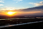 Nederland, Utrecht, gemeente Wijk bij Duurstede, 15-11-2010. Zonsondergang boven de meanderende Lek ter hoogte van Wijk bij Duurstede. Onder in beeld het kaarsrechte Amsterdam-Rijnkanaal..Sunset over the meandering river Lek  with at the bottom of the screen the straight Amsterdam-Rhine canal..luchtfoto (toeslag), aerial photo (additional fee required).foto/photo Siebe Swart