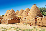 """Pictures of the beehive adobe buildings of Harran, south west Anatolia, Turkey.  Harran was a major ancient city in Upper Mesopotamia whose site is near the modern village of Altınbaşak, Turkey, 24 miles (44 kilometers) southeast of Şanlıurfa. The location is in a district of Şanlıurfa Province that is also named """"Harran"""". Harran is famous for its traditional 'beehive' adobe houses, constructed entirely without wood. The design of these makes them cool inside. 44 .<br /> <br /> If you prefer to buy from our ALAMY PHOTO LIBRARY  Collection visit : https://www.alamy.com/portfolio/paul-williams-funkystock/harran.html<br /> <br /> Visit our TURKEY PHOTO COLLECTIONS for more photos to download or buy as wall art prints https://funkystock.photoshelter.com/gallery-collection/3f-Pictures-of-Turkey-Turkey-Photos-Images-Fotos/C0000U.hJWkZxAbg ."""