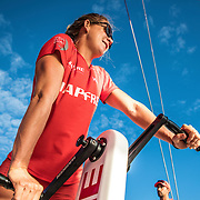 Leg 4, Melbourne to Hong Kong, day 10 on board MAPFRE, Sophie Ciszek triming at the mid pedestal and looking at Turn the Tide in the horizon. Photo by Ugo Fonolla/Volvo Ocean Race. 11 January, 2018.