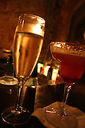 Spumante sparkling wine and strawberry daiquiri at a modern bar in Palermo.