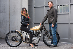 Moisa Silva Marinho models beside Stefano Martinelli of PDF Motociclette's (Punto Di Fuga) on PDF's custom 1927 Harley-Davidson JD Racer 1000cc that was on display at Motor Bike Expo. Verona, Italy. January 24, 2016.  Photography ©2016 Michael Lichter.