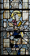 Medieval stained glass window of an angel inside the church at South Elmham All Saints, Suffolk, England, UK