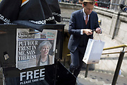 A City worker climbs steps at Bank Underground station, past Evening Standards with Prime Minister Theresa May on the front page, asking the nation to trust her and yesterday's snap election announcement, in the heart of the capital's financial district, on 19th April, in the City of London, England.