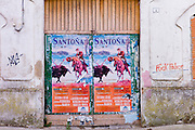 Plaza de Toros de Santona bullfight poster and anti-police abusive slogan in Cantabria, Northern Spain