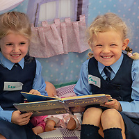 Rose Rogers and Jenny O'Brien play together in the wendy house on their First day at school at Scoil Na Mainistreach Quin Dangan