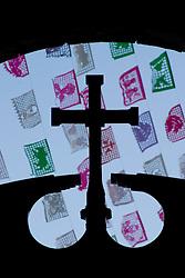 Mexico, Yucatan, Valladolid, La Parraquia de San Servacio church, Christian cross and colorful flags