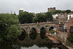 © Licensed to London News Pictures. 09/07/2016. Durham, UK. The procession of banners and bands make there way over the Elvet Bridge in Durham during the Durham Miners' Gala. The gala is a large gathering held annually associated with the coal mining heritage and trade unionism. Photo credit : Ian Hinchliffe/LNP