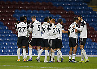Football - 2020 / 2021 Premier League - Burnley vs. Fulham<br /> <br /> Fulham players celebrate with Ola Aina after scoring his team's first goal to put them 1-0 ahead at the start of the second half, at Turf Moor.<br /> <br /> <br /> COLORSPORT/ALAN MARTIN