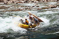Rafters going into a hole while rafting the Grand Canyon. Grand Canyon National Park, AZ.