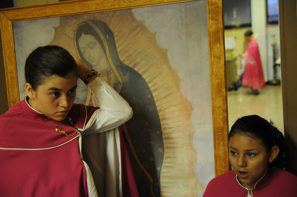 Members of  Niños Cantores de Morelia prepare for their performance before a packed audience at St. Gall Parish on Chicago's southwest side.