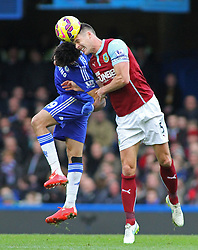Chelsea's Diego Costa and Burnley's Jason Shackell compete for the ball - Photo mandatory by-line: Mitchell Gunn/JMP - Mobile: 07966 386802 - 21/02/2015 - SPORT - Football - London - Stamford Bridge - Chelsea v Burnley - Barclays Premier League