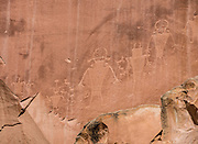 Petroglyphs pullout on Utah Highway 24 in Capitol Reef National Park, USA: These petroglyphs (carvings in stone) were created about 300-1300 CE and are attributed to the Hisatsinom (called the Fremont Culture by Euro-American archeologists). Today's Hopi and Zuni people say these markings confirm presence of their ancestors in Capitol Reef. The Paiute Tribe calls the former inhabitants Wee Noonts (People Who Lived the Old Ways).