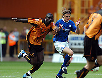 Fotball<br /> Foto: Fotosports/Digitalsport<br /> NORWAY ONLY<br /> <br /> Date: 28/08/2004<br /> <br /> WOLVERHAMPTON WANDERERS v LEICESTER CITY <br /> <br /> COCA COLA CHAMPIONSHIP <br /> <br /> SEYI OLOFINJANA WOLVES & LILIAN NALIS LEICESTER