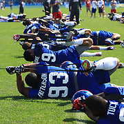 New York Giants players stretching during the 2013 New York Giants Training Camp at the Quest Diagnostics Training Centre, East Rutherford, New Jersey, USA. 29th July 2013. Photo Tim Clayton.