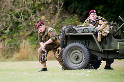 reenactors portray members of 21 Independent Parachute Company, 6th Airborne Division during a battle reenactment at Sheffield Fair at Norfolk Heritage Park Sheffield Bank Holiday Weekend.28th & 29th August 2011 Image © Paul David Drabble